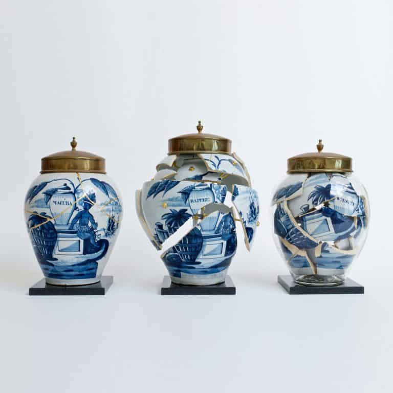 Bouke de Vries Tobacco Jar Garniture, 2020 Contemporary glass following the original form of its contents; three 18th century blue and white Dutch Delft vases with brass lids and marble bases