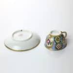 A Sèvres Miniature Cup & Saucer reverse
