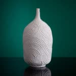 Meandering Vessel, 2020 Thrown and carved porcelain by Andrew Wicks on a green background