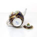 A Sèvres Teapot (théière Calabre) beau bleu, birds in landscapes, factory mark, date letter M for 1765, painter's mark for Aloncle