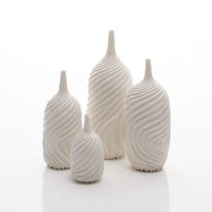A set of four white porcelain carved vases