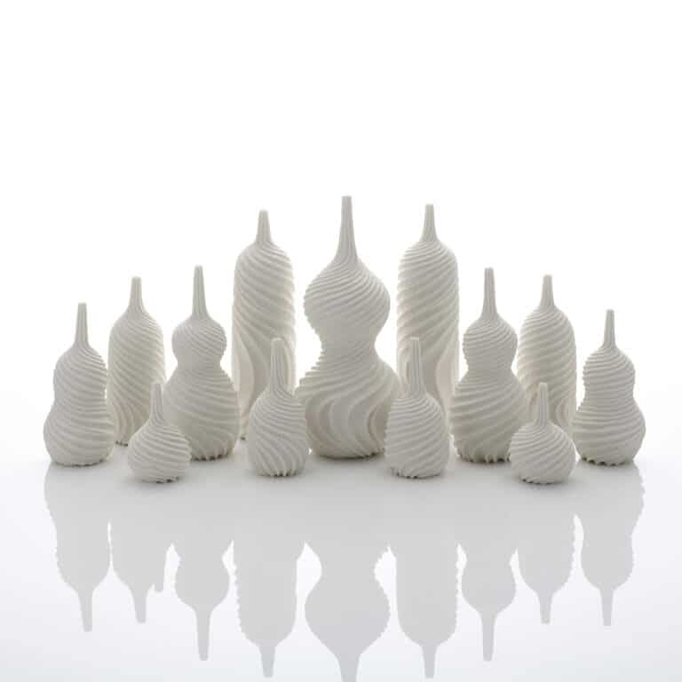 A Garniture of Thirteen Twisted Vases, 2020 Thrown and carved white porcelain