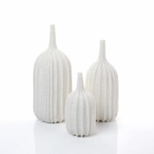 Andrew Wicks trio of carved white porcelain vases