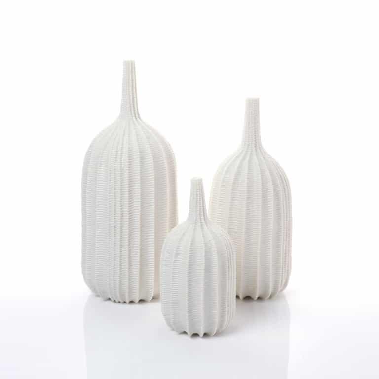 Andrew Wicks trio of carved white porcelain vases
