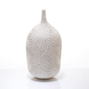 A carved porcelain vase by andrew wicks