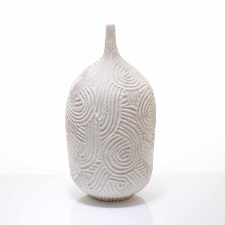 A carved porcelain vase by andrew wicks