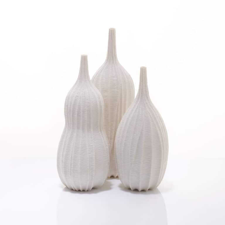 Andrew Wicks trio of carved porcelain vases